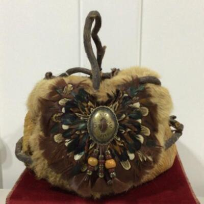Basket with fur and feather detail