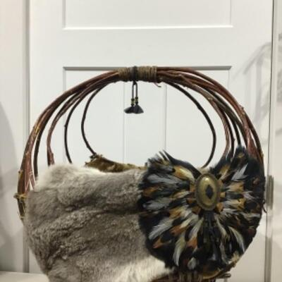 Large basket with fur and feathers