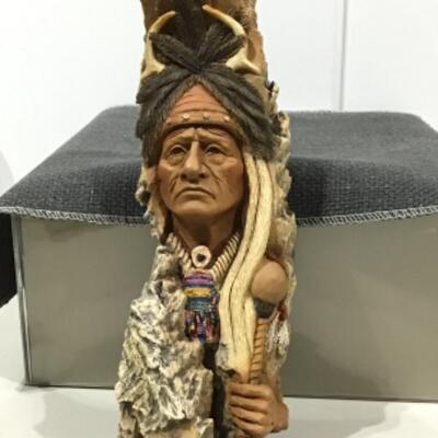 Crow medicine chief carving