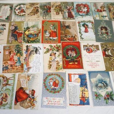 36 Antique Christmas Postcards. Many are rare cards with Santa in various costumes and also many with children..Circa 1900-1915. Die Cut,...