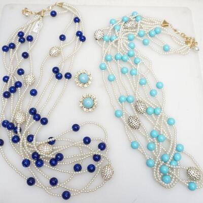 Two Joan Boyce 5 Strand Pearl, Bead and Crystal Necklaces. One with Faux Turquoise Beads. the other with Faux Lapis Beads each...