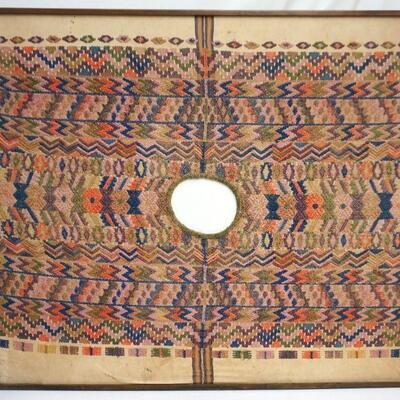 Framed (no glass) Antique South or Central American (Peru, Bolivia, Guatemala) woven child's tunic vest or poncho. Measures 37