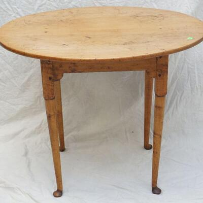 A very fine Antique American 18th c. country Queen Anne Tea Table. Two board oval maple top with tapered legs on pad feet. 3rd quarter...