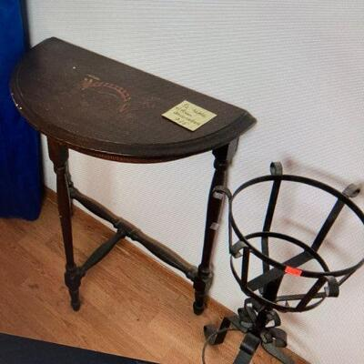 Half table with Asian decoration & iron plant stand