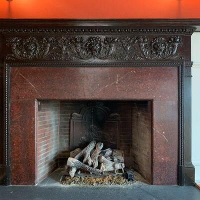 Late 19th Century Hand Carved Fireplace Surround with Roaring Lion Heads