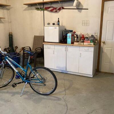 Small fridge, cabinet & bike