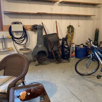 Outdoor fireplace, wheel barrow, etc.