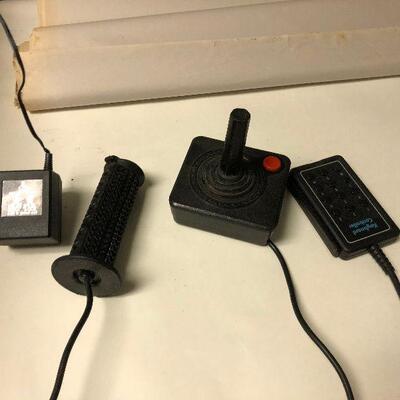 https://www.ebay.com/itm/124543345267BM4004 Atari 2600 Accessories; Joystick, Paddles, Keyboard Controller, Adtr AC Untested Auction