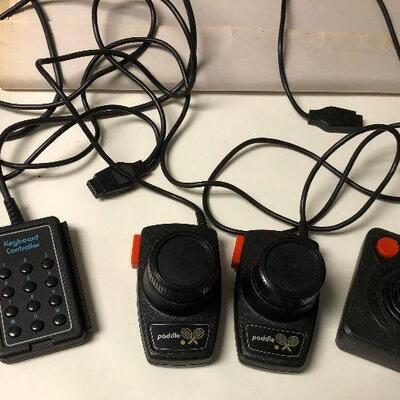https://www.ebay.com/itm/124543336936BM4003 Atari 2600 Accessories; Joystick, Paddles, Keyboard Controller Untested Auction