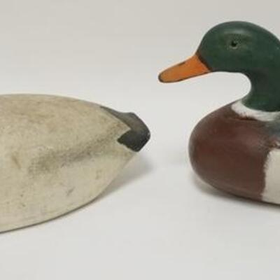 1003	2 CARVED WOOD DUCK DECOYS, LARGEST IS 16 IN X 8 1/4 IN