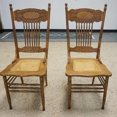 1054PAIR OF OAK PRESSED BACK CHAIRS