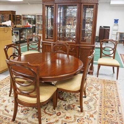1011	BASSETT DINING ROOM SET, BREAKFRONT, 53 IN ROUND TABLE W/ONE 24 IN LEAVE & A SET OF 6 CHAIRS