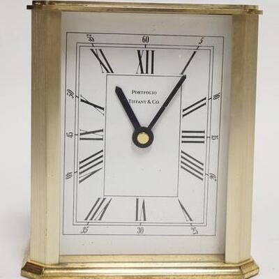 1092TIFFANY & COMPANY PORTFOLIO DESK CLOCK IS BATTERY OPERATED. 5 IN H 5010020PLEASE PAY ATTENTION FOR DAILY ADDITIONS TO THIS SALE....