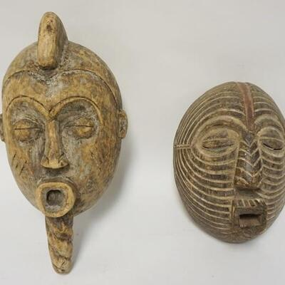 1006	LOT OF 2 ETHNIC WOOD CARVED MASKS, 17 IN X 7 IN