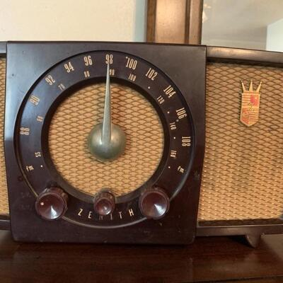 Vintage Zenith Electric AM FM Radio. Tested and works. Measures approximately 12 in x 7in x 7 1/2 in.