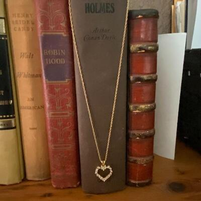 Heart shaped 14 k diamond pendant on 18 inch chain. Chain has safety latch and 4.0 g total wt.