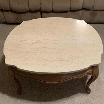 Marble Top and wood Coffee Table. Top is removable. Measures 31 1/2 sq. And 15 inches tall.