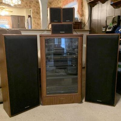 Technics Stereo System. Includes speakers and surround sound. All the cabinets are approximately 3 feet tall.