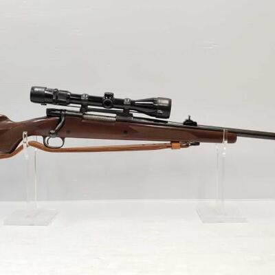 #952 • Winchester 70 7MM Rem Mag Bolt Action Rifle And Scope