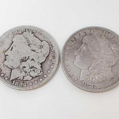 #2550 • 1878 and 1883 Morgan Silver Dollars