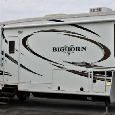 2014  Bighorn 3685RL with low mileage in excellent condition. This rear living Bighorn fifth wheel has got you covered with everything...