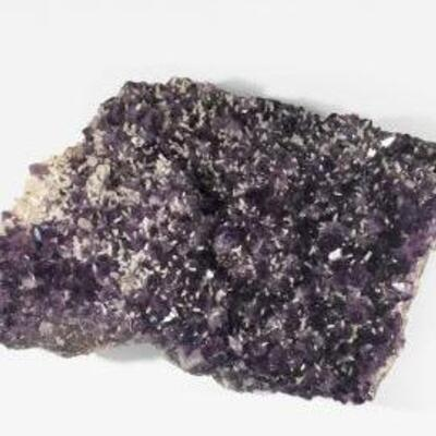 Giant, Grade A+ Amethyst from Uruguay featuring white Quartz clusters throughout. Would be beautiful on a table or inside the fireplace...