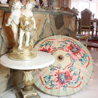 Marble Table with Cherub Figurines
