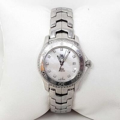 #557 • Tag Heuer Link Watch - Authenticated casing measures approx 26mm.
