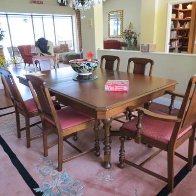 ANOTHER VIEW OF THE DINNING ROOM TABLE AND 8 MATCHING CHAIRS