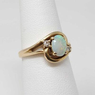 251	  14k Gold Ring With With Diamonds And Opal, 3.5g Weighs Approx 3.5g. Size 6.5.