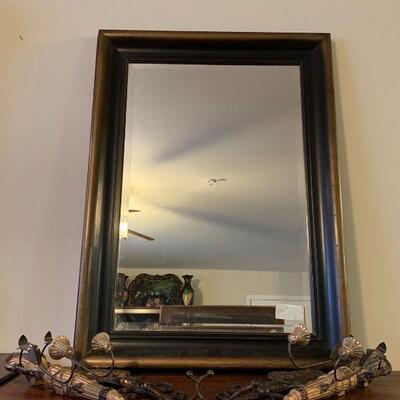 Wood framed mirror with 1 inch beveled cut face. The frame is heavy and well made. There is a set of mirrored plate holders with metal...