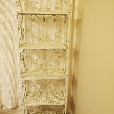 White distressed look wrought-iron rack. Measurements 22x12x72