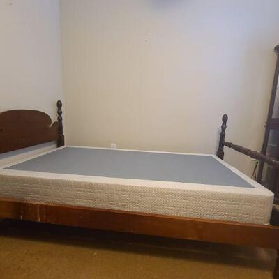Wooden bed frame does come with box spring but no mattress. Measures 80