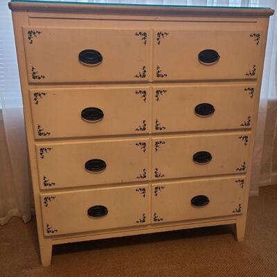 Beautiful white four drawer dresser with painted on ivy. In good condition, measures 36