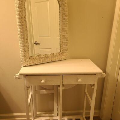 Cart and mirror both white. Mirror is framed in white painted wicker. Mirror measures 20