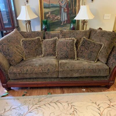 Classique style sofa with rolled arms. Green floral patterns with decorative flourishes and beautiful artistic wooden trim. Comes with 12...