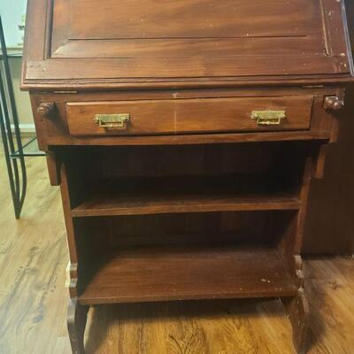 Writing desk is in decent condition. Measures 29