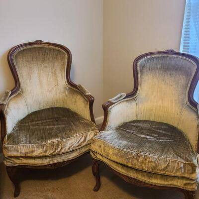 Two vintage chairs in ok condition, they have a small flower detail on front legs, middle bottom frame and middle top of frame. Measures...