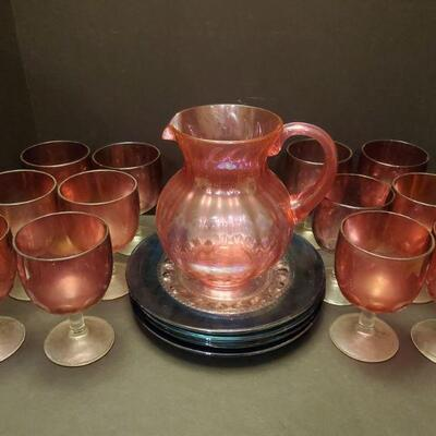 Set of 12 heavy purple glass goblets with clear stems are 6