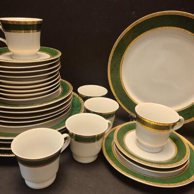 Set of twenty eight pieces of beautiful china with green and gold edges. Five tea cup plates measuring 6