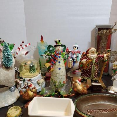 Assorted Christmas decorations includes cute snowmen, Santa and more. Snow globe plays music but is not working....