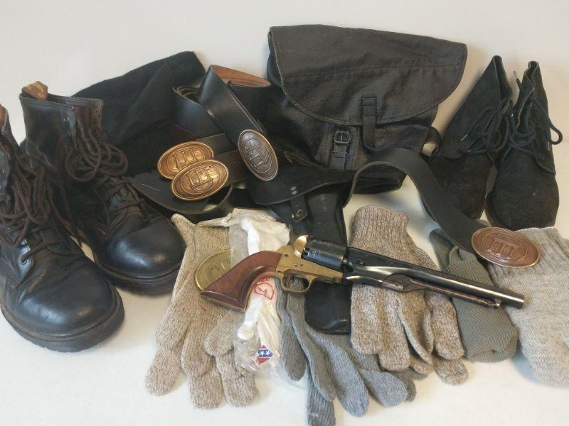 Reenactment pistol with holster and leather belt. Boots are Men's sizes 9 1/2 and 10. Gloves and belts are XL. Also comes with socks, extra belts and buckles, scarf, and satchel.  https://ctbids.com/#!/description/share/768472