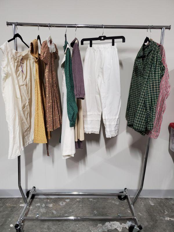 Children's collection of Civil War Reenactment clothing. Includes dresses, shirts and more. Dresses appear to be small, boys shirt are small. Rack not included  https://ctbids.com/#!/description/share/768508