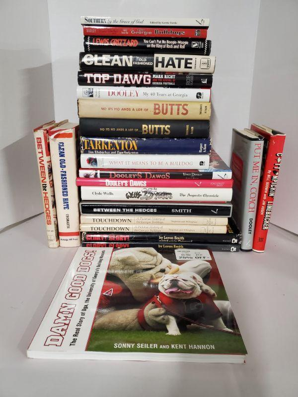 Large collection of hardcover books of the Georgia Bulldogs and Vince Dooley and other miscellaneous books.  https://ctbids.com/#!/description/share/768507