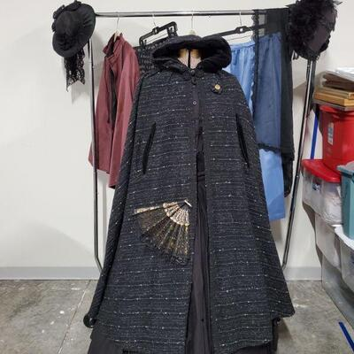Beautiful collection of women's Civil War Reenactment clothing. Black outfit is 2 piece with cloak, hoop skirt and fan. Clothing is size...