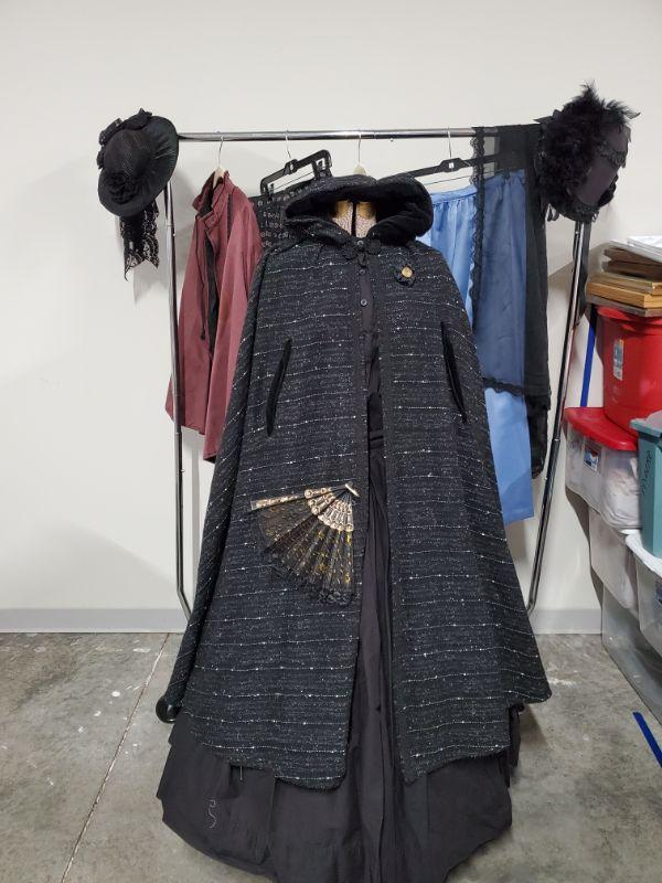 Beautiful collection of women's Civil War Reenactment clothing. Black outfit is 2 piece with cloak, hoop skirt and fan. Clothing is size L to 2XL. Mannequin and clothing rack not included.  https://ctbids.com/#!/description/share/768503