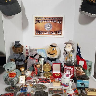 Large collection of Civil War memorabilia. Includes belt buckles, pins, rubber stamps, hats, stuffed animals and more. Doll stands not...
