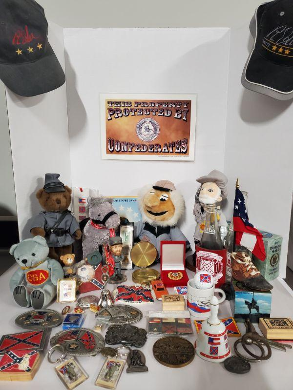 Large collection of Civil War memorabilia. Includes belt buckles, pins, rubber stamps, hats, stuffed animals and more. Doll stands not included.  https://ctbids.com/#!/description/share/768477