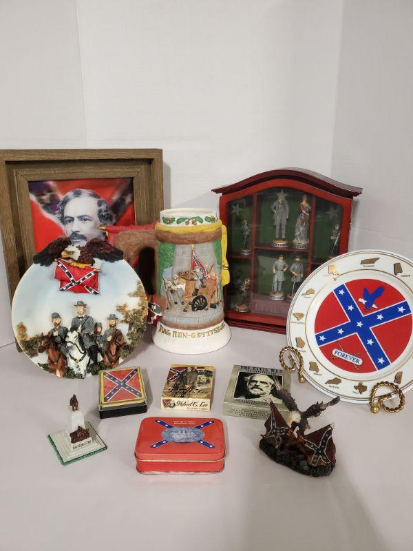 """Collection of Civil war and Robert E. Lee memorabilia. Includes plates, playing cards and more. Stein 9.5"""" Plates 9"""" Framed picture 11x14"""" Civil War shadow box is 10x12x3"""" with 8 figures that are 3-4"""".  https://ctbids.com/#!/description/share/768504"""