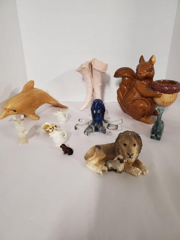"""Collection of animals. Includes a cute ceramic squirrel with acorn that can hold a candle votive 7"""", a wooden dolphin, glass octopus and more.  https://ctbids.com/#!/description/share/768476"""